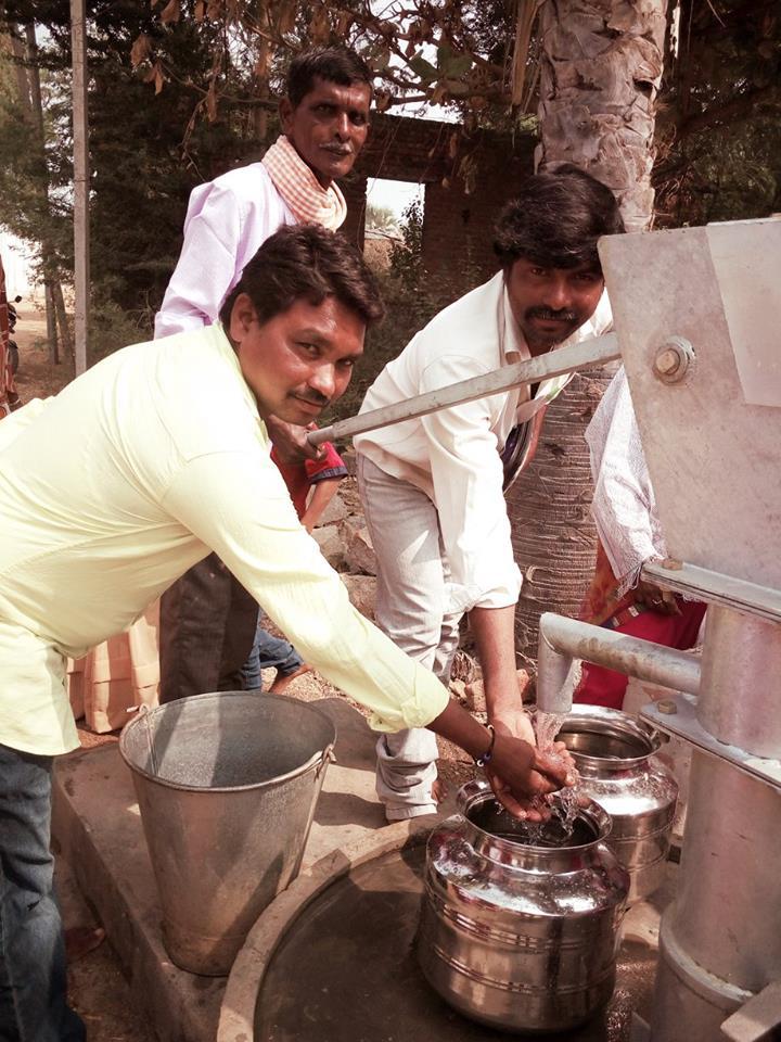 Men around well India