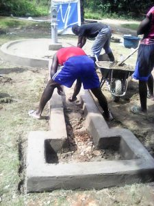 Finishing the African water well apron